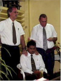 Rev. Hamid being ordained by Rev. Donnan and Rev. Poettcker